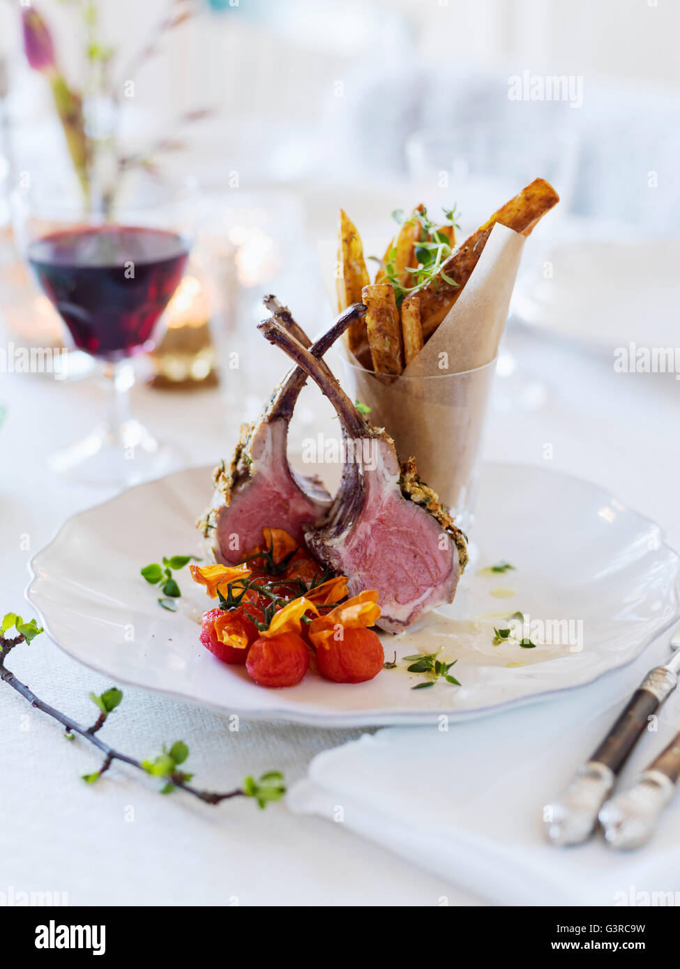Sweden, Lamb chops and french fries on table - Stock Image