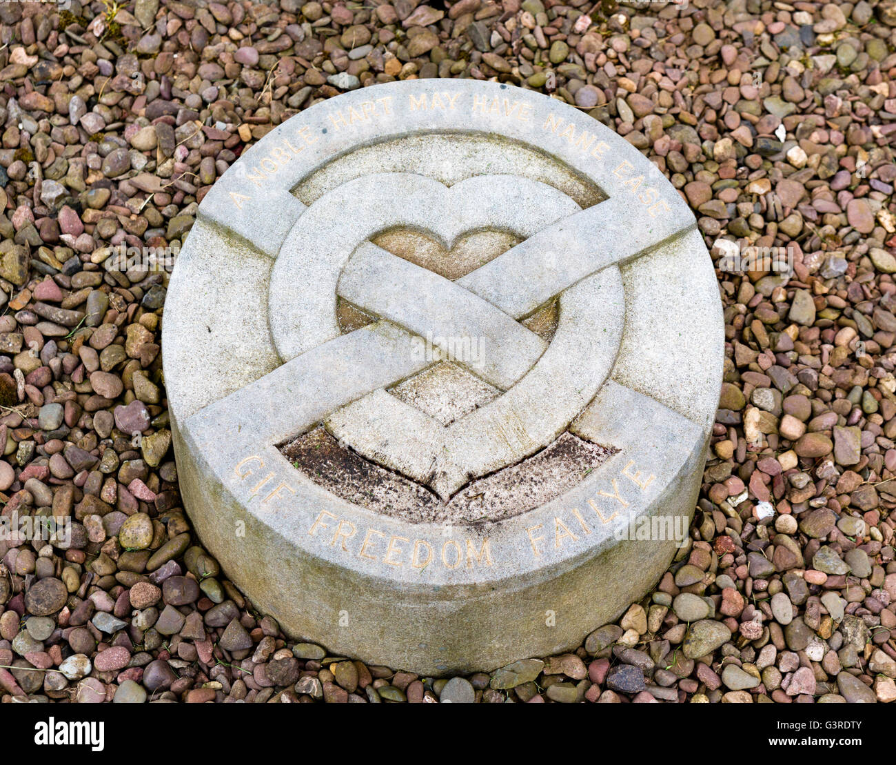 Marker for the site of the burial of the heart of Robert the Bruce, Melrose Abbey (St Mary's Abbey), Scottish - Stock Image