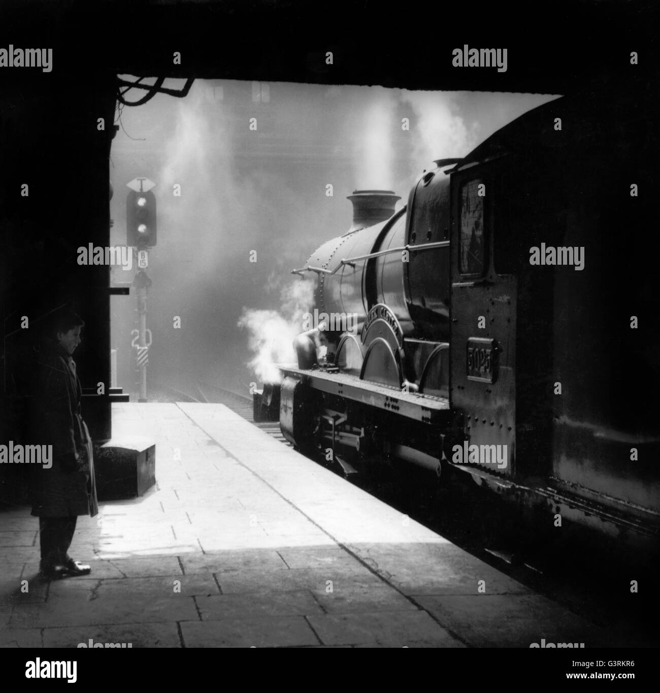 Arthur Mace has captured the full excitement of a departing express. - Stock Image