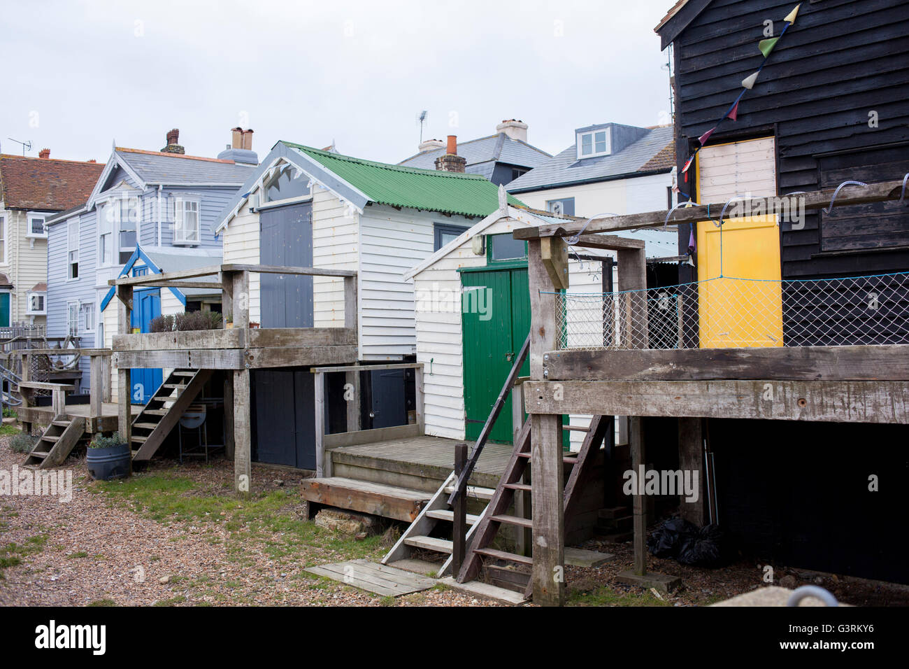 A row of beach and fishing huts along the front in the Kentish fishing town of Whitstable Stock Photo