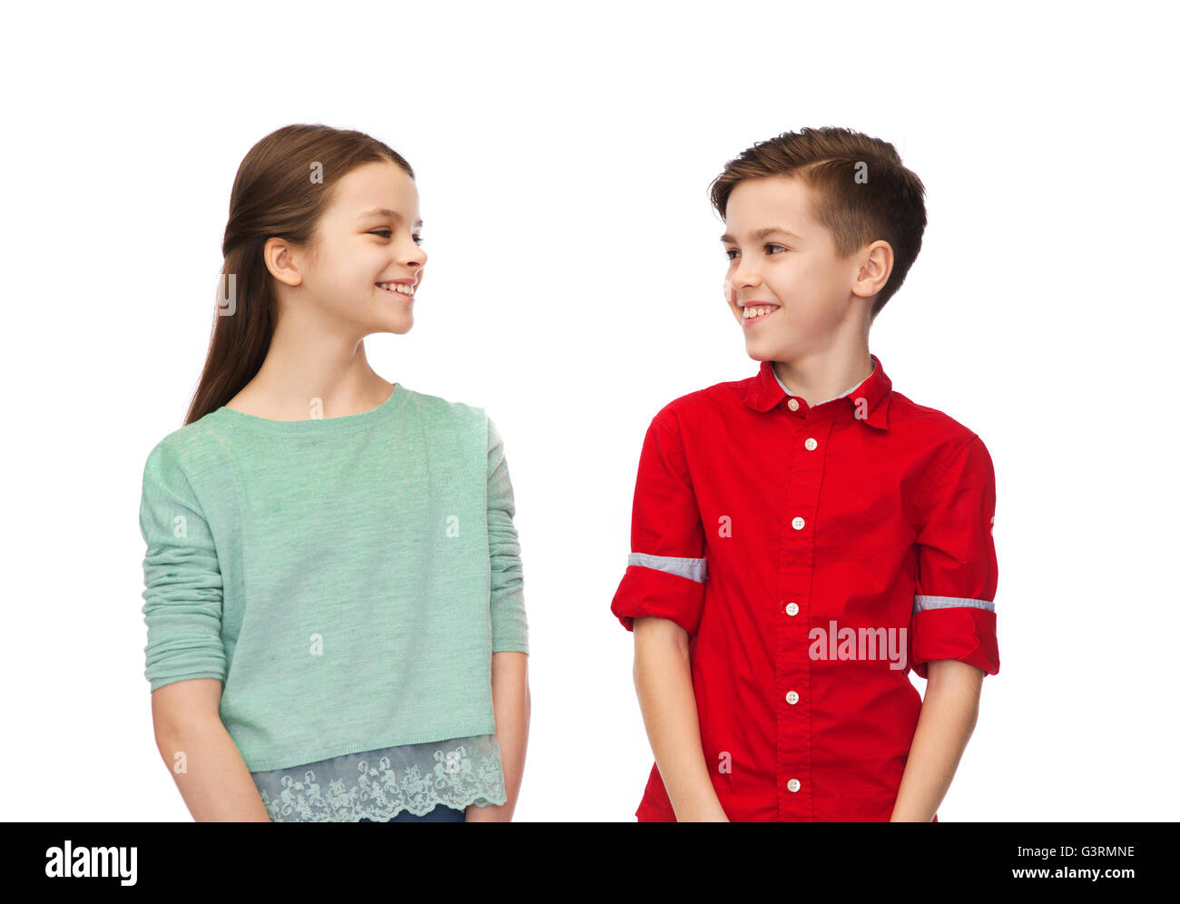 happy boy and girl looking at each other - Stock Image