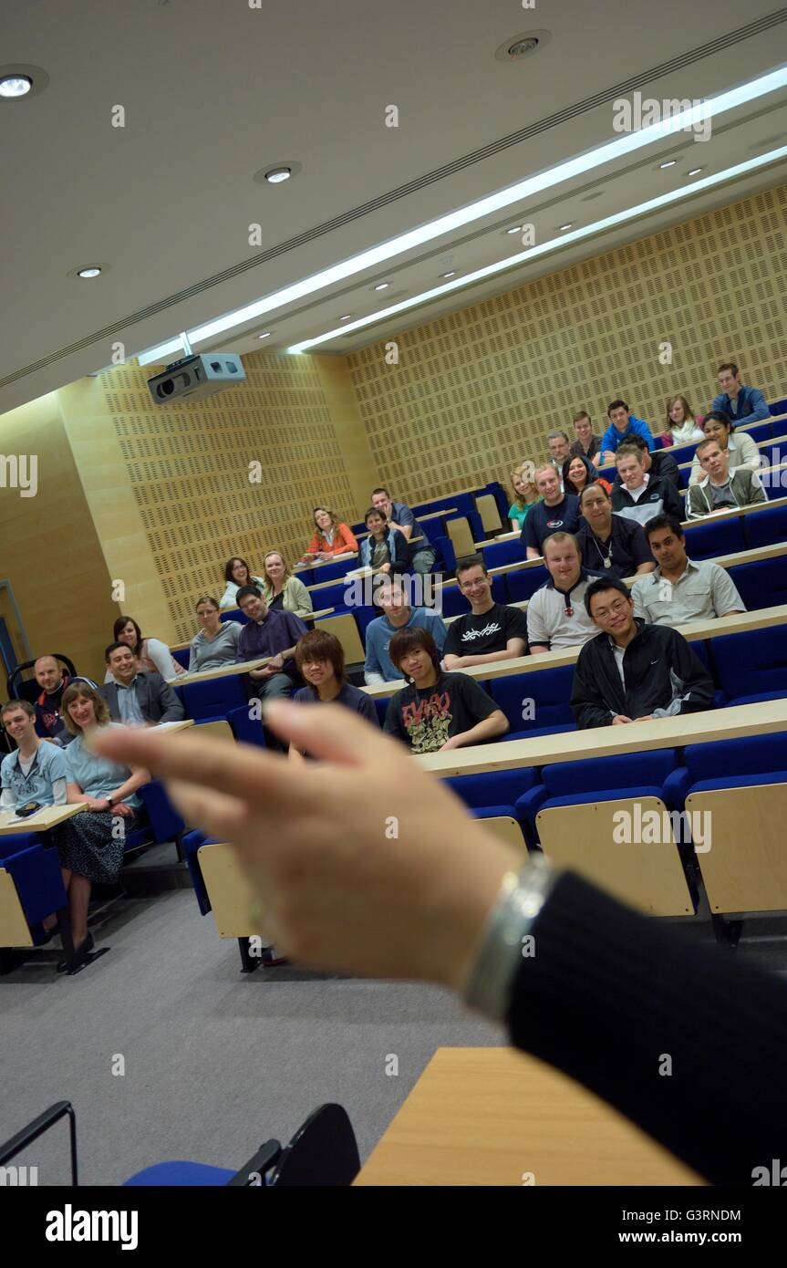 Lecturer in front of students in the lecture theatre. Hastings. England. UK - Stock Image