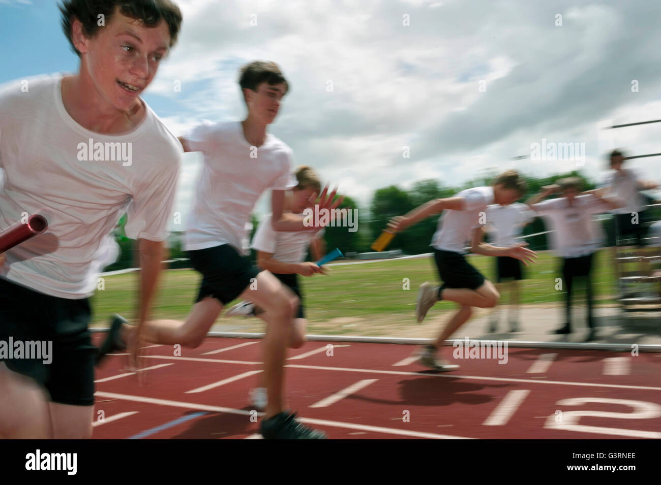 Relay finish at a school sports day. England. UK - Stock Image