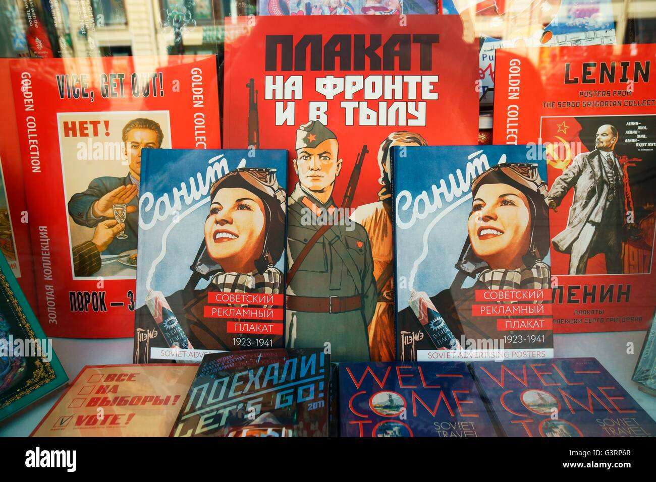 Saint Petersburg Russia. Modern books present patriotic Soviet era graphic art in bookstore window display on Nevsky - Stock Image