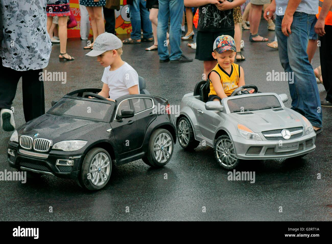 Saint Petersburg, Russia. Boys test drive German import cars on Ostrovsky Square during annual St. Petersburg City - Stock Image