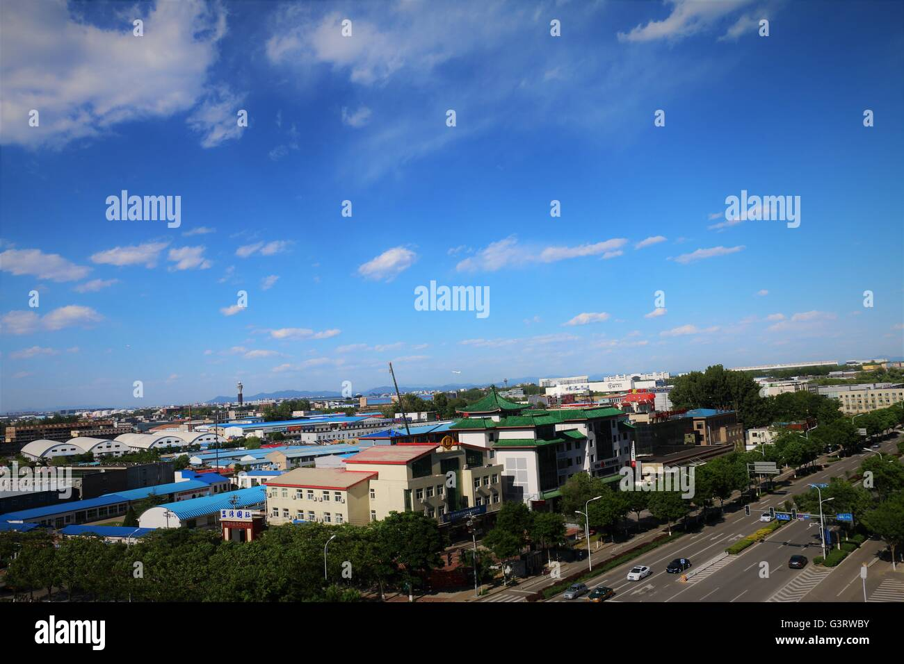 Urbanization. An urban scene with beautiful blue sky Stock Photo