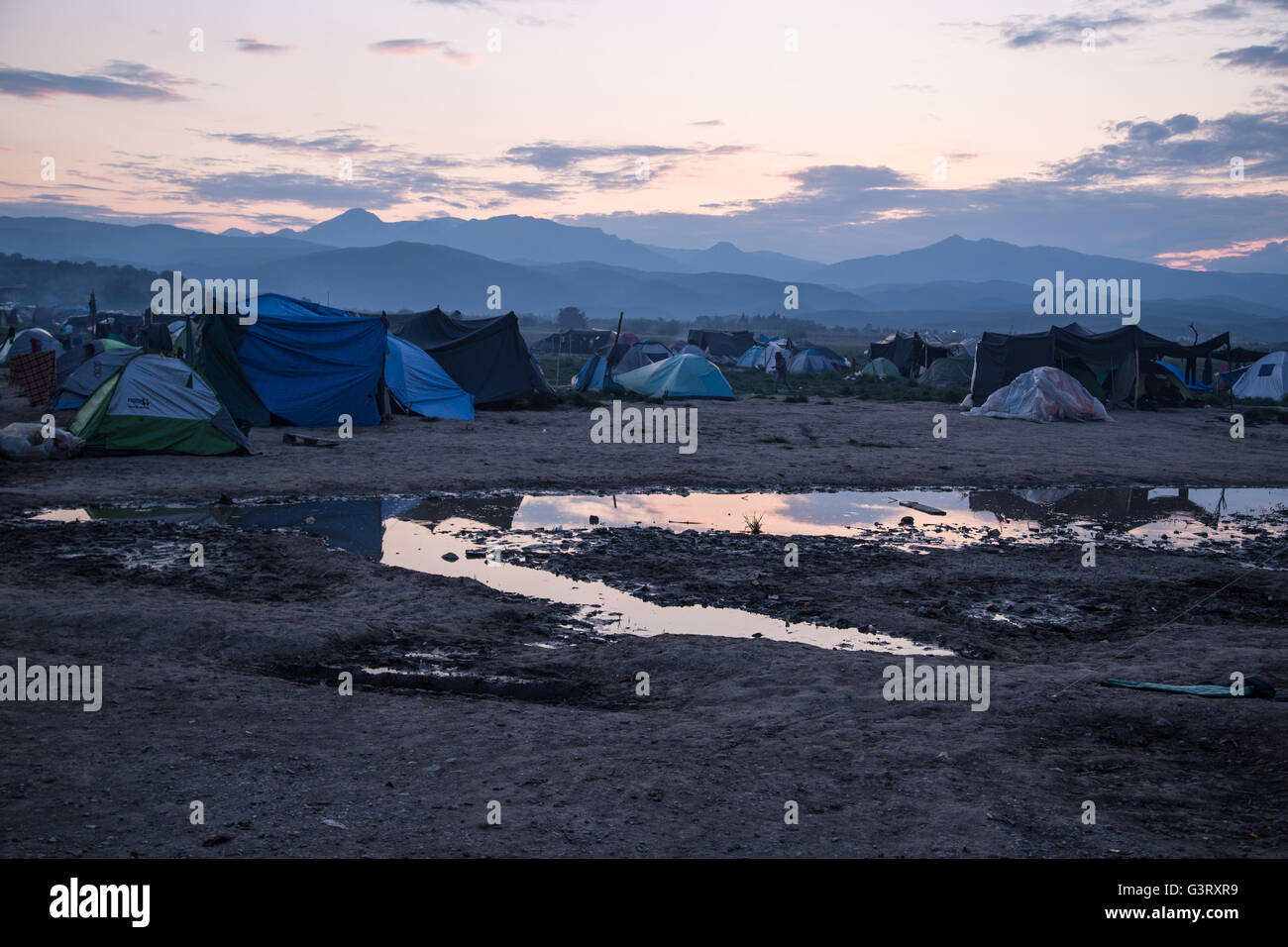 Conditions at the Syrian refugee camp of Idomeni, Greece, after a spring rain, with tents and puddles visible. - Stock Image