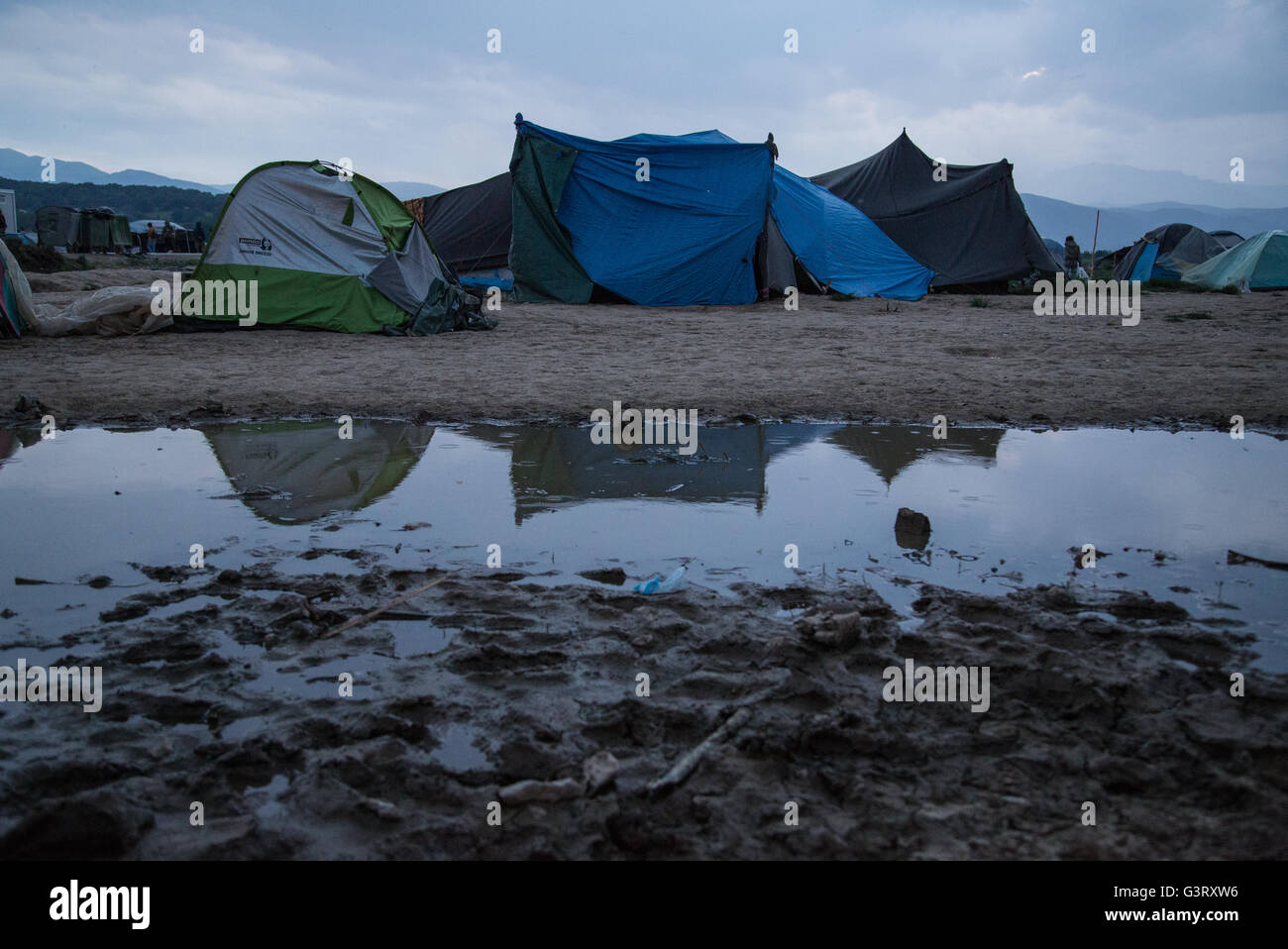 Reflections of the tents in the Syrian refugee camp of Idomeni (Eidomeni) at the Greek - Macedonian border. - Stock Image