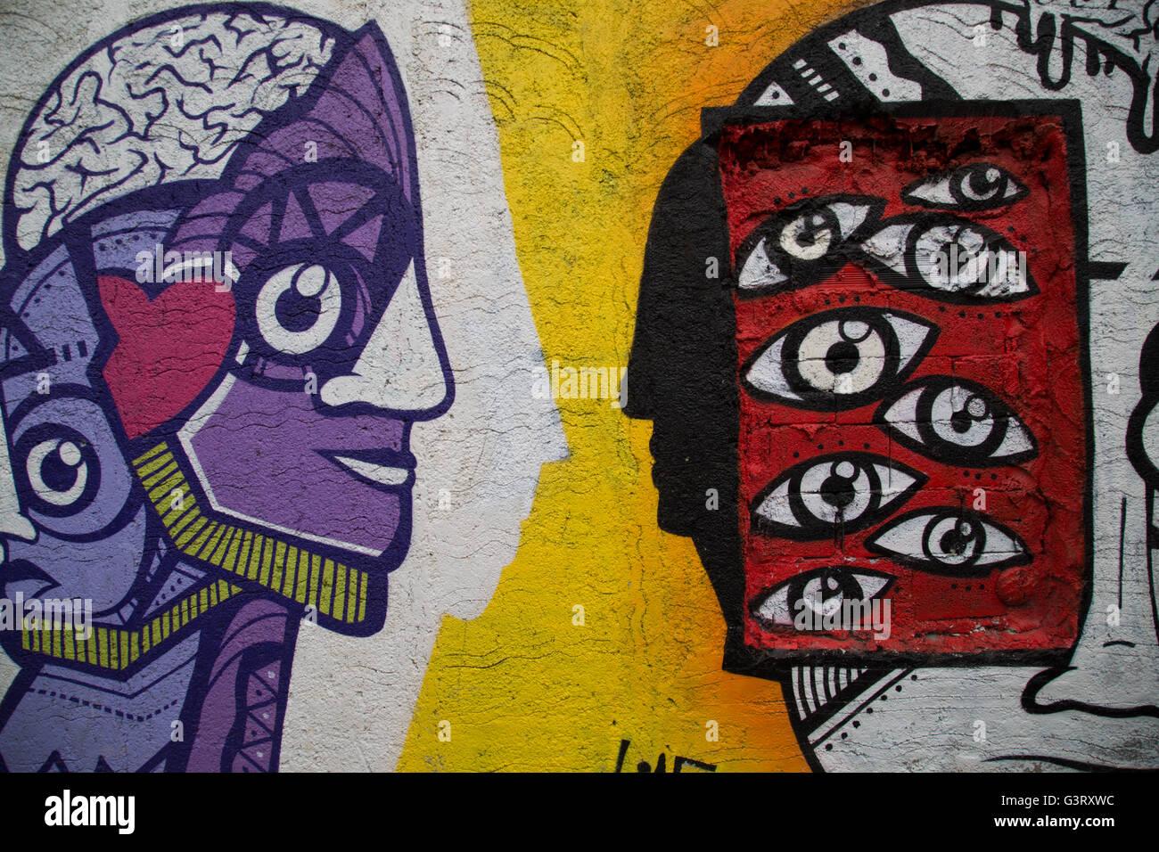 Street art (graffiti) in the alleys of the scenic neighborhood of Anafiotika in Athens, Greece. Stock Photo