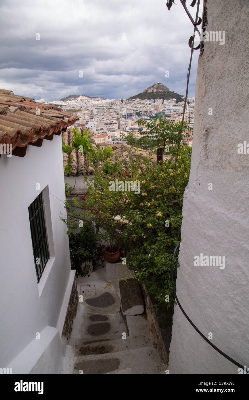 View of Athens and Lycabettus hill from the scenic neighborhood of Anafiotika in central Athens, Greece. Stock Photo