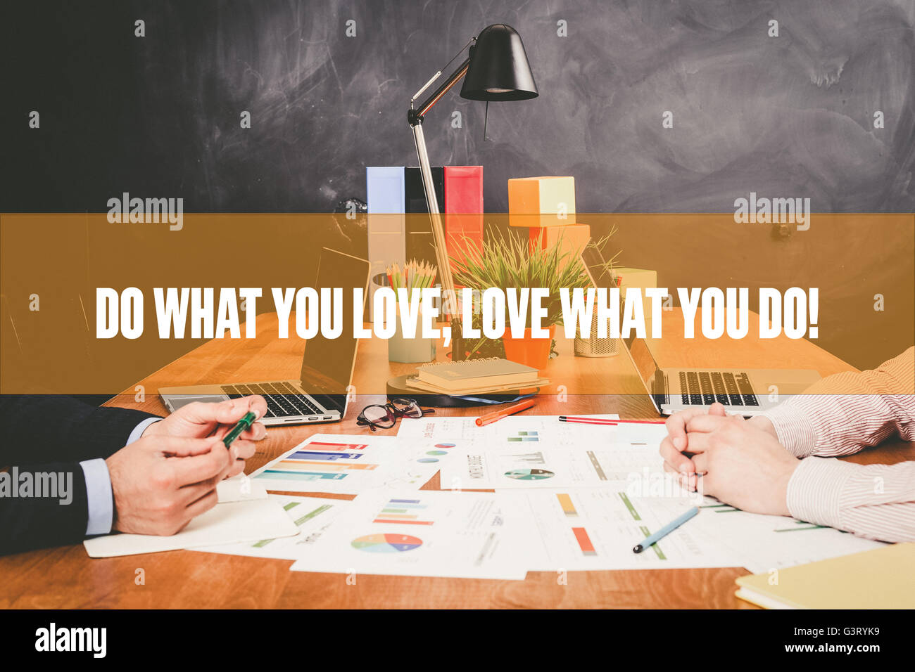 Two Businessman  Do What You Love, Love What You Do working in an office - Stock Image