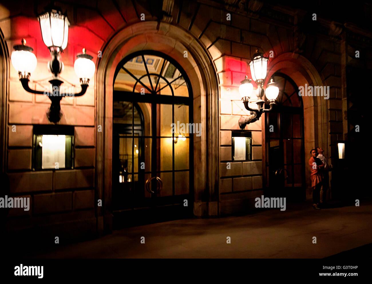 Copenhagen, Denmark, entrance of the Royal Danish Theatre in Kongens Nytorv at night. - Stock Image