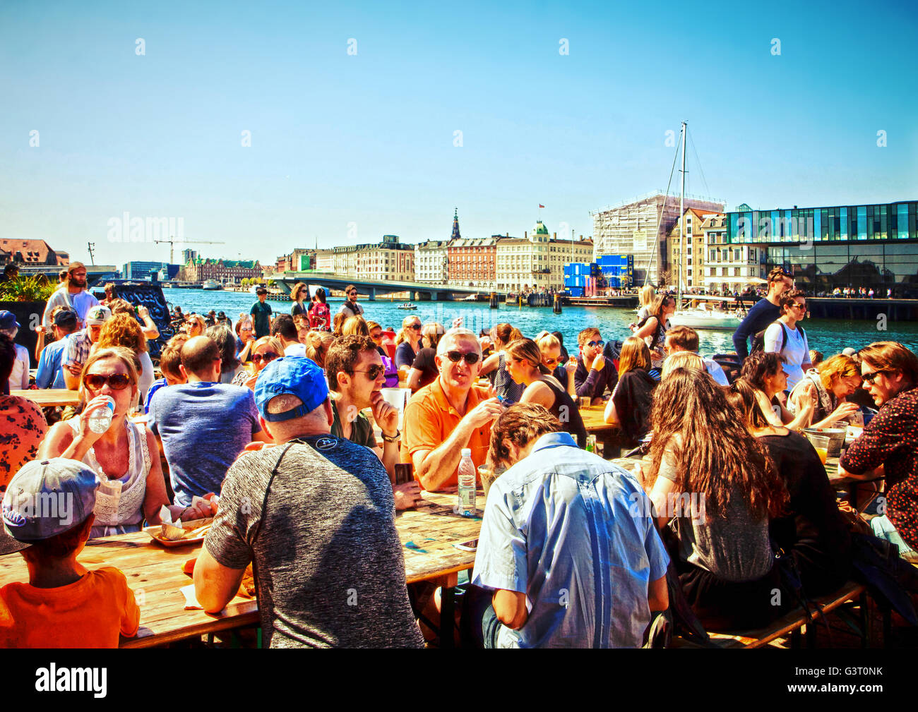 Copenhagen - people enjoy the beautiful weekend eating outside at street food market of Paper Island - Stock Image