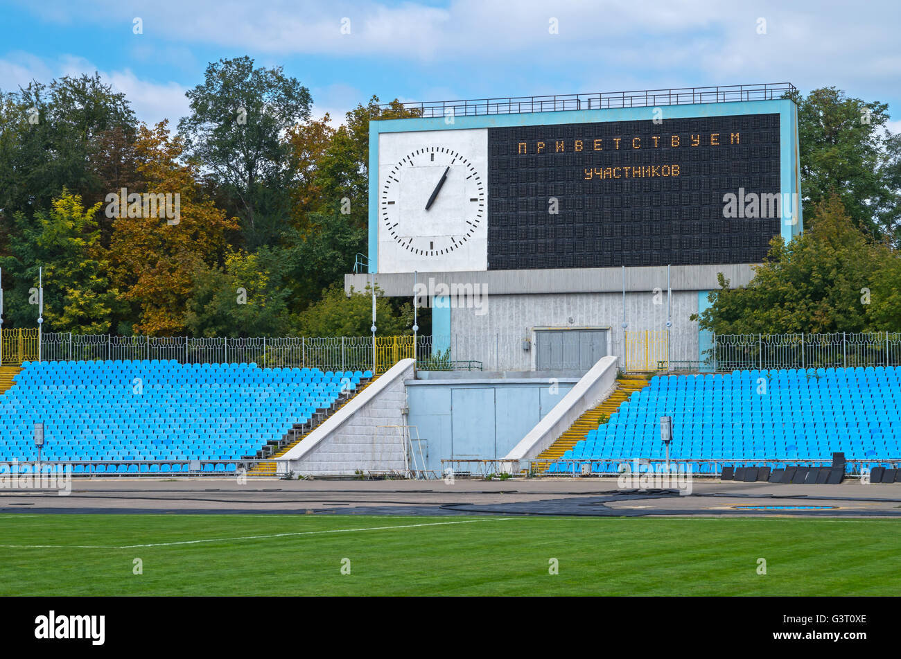 The display device and the entrance gates to the stadium in a provincial town - Stock Image