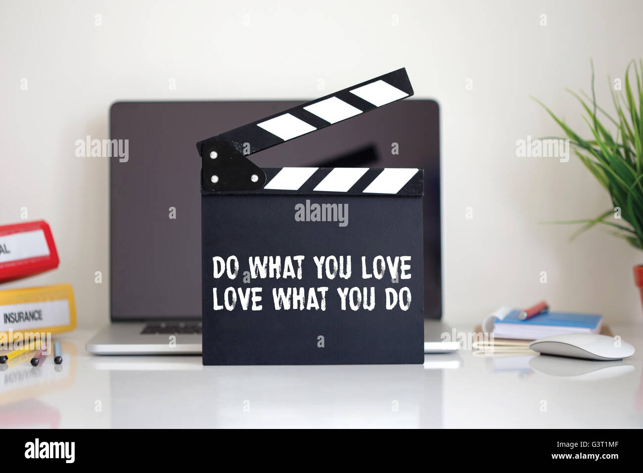 Cinema Clapper with Do What You Love, Love What You Do word - Stock Image