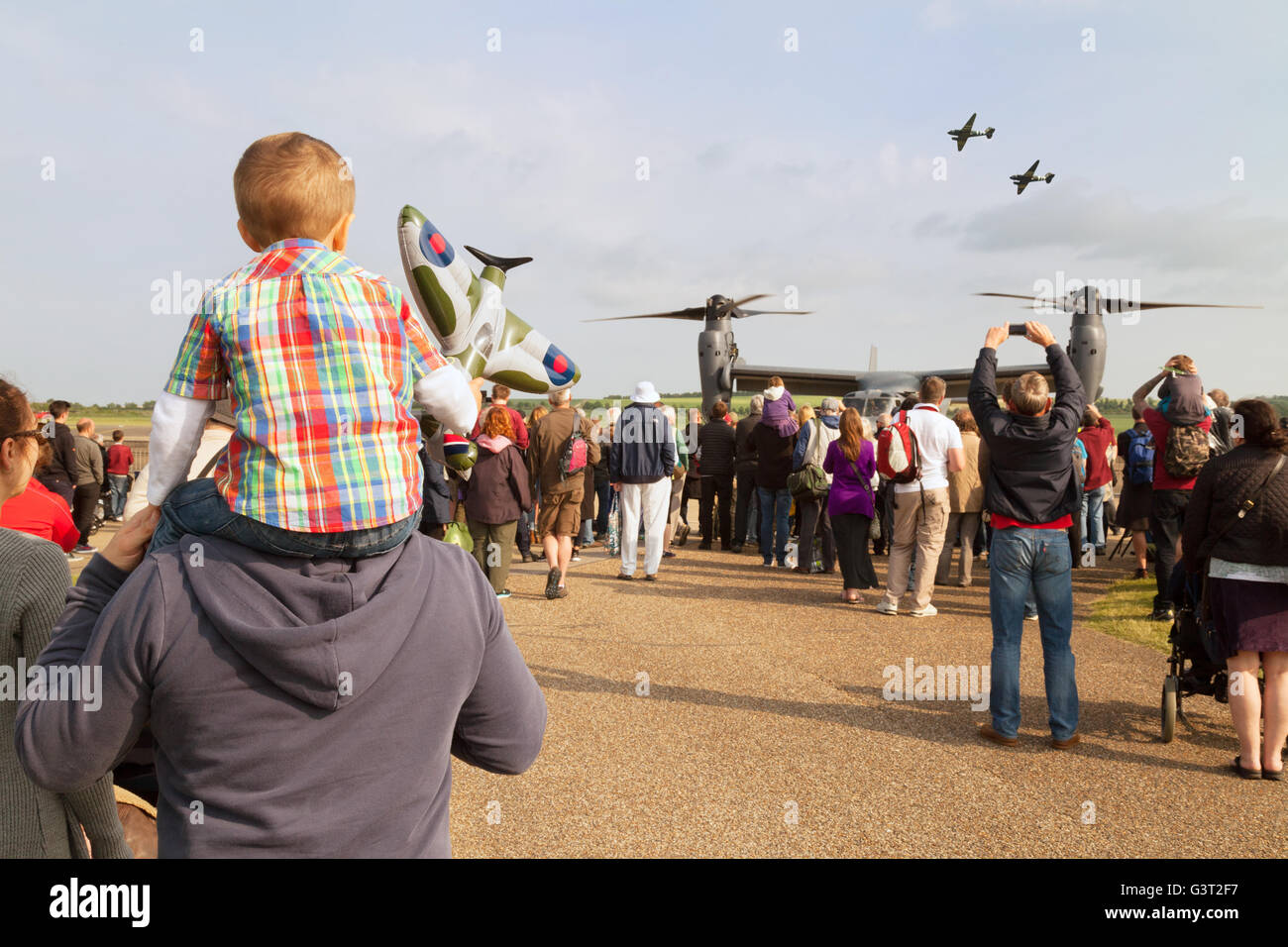 People including families and children at the Duxford American Airshow, Duxford Air Museum, Cambridgeshire UK - Stock Image