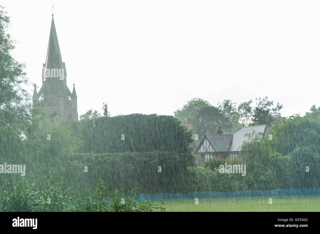 Heavy showers have been the theme of the afternoon in Reading. St. Michael's Church in Reading is seen through - Stock Image