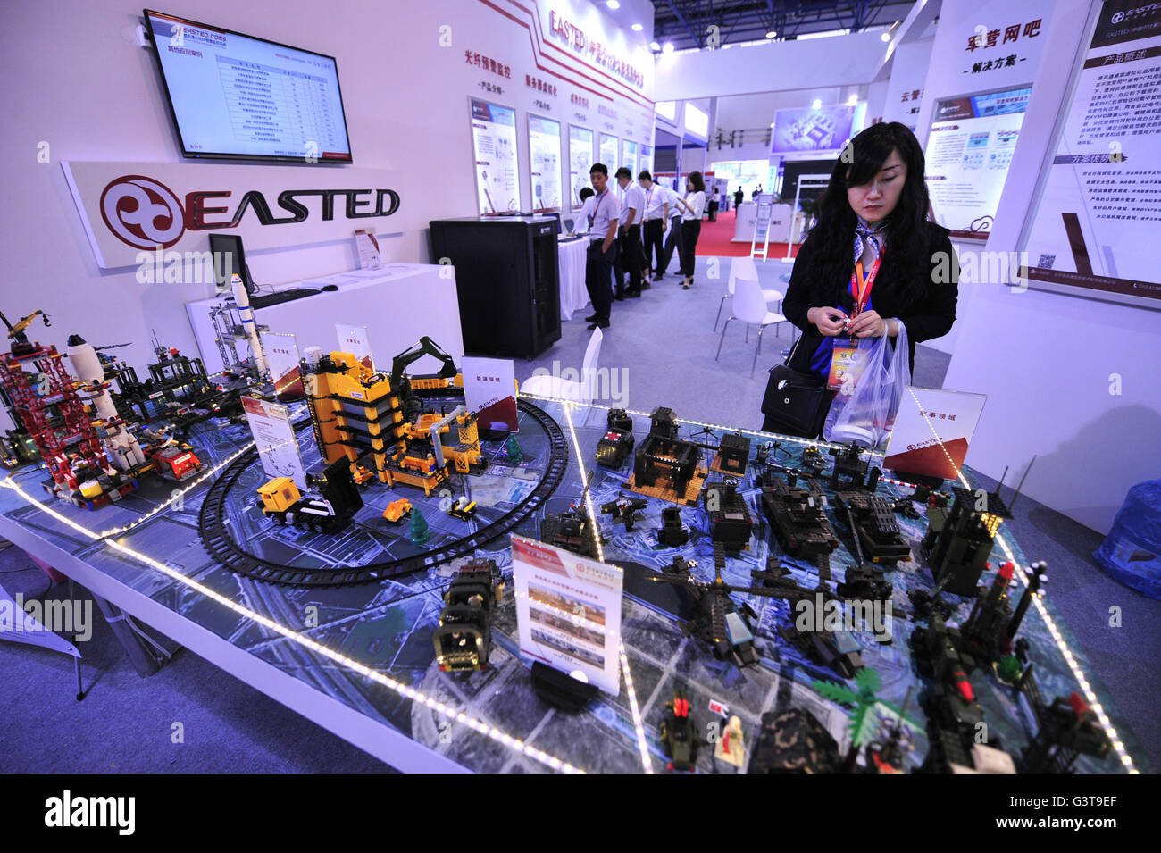 Beijing, China. 15th June, 2016. A model of a monitoring and early-warning system is shown at Chinese Defense Information Stock Photo