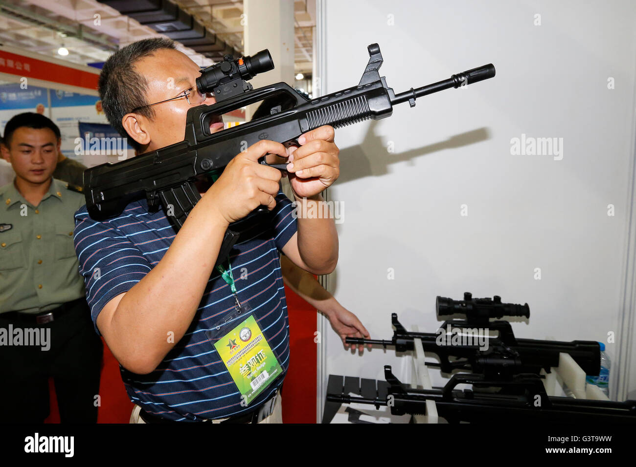 Beijing, China. 15th June, 2016. A visitor tries a gun targeting system at Chinese Defense Information Equipment Stock Photo