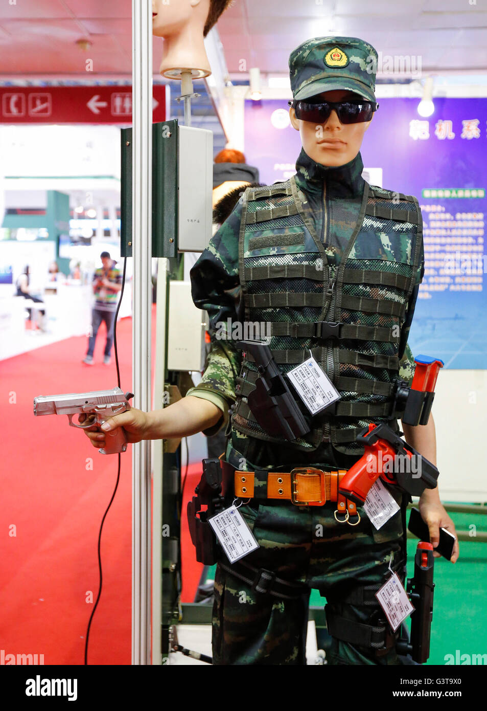 Beijing, China. 15th June, 2016. A visitor tries a holster at Chinese Defense Information Equipment & Technology Stock Photo