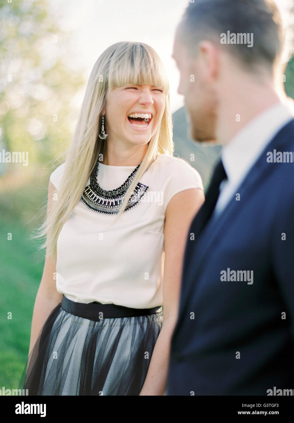 Sweden, Portrait of laughing bride and groom - Stock Image
