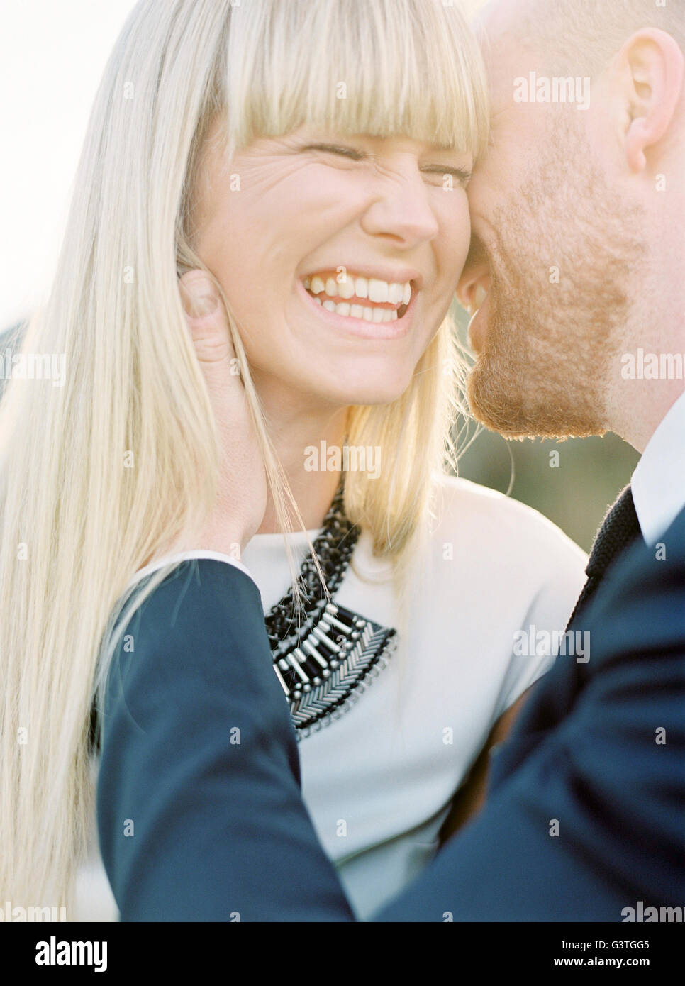 Sweden, Groom kissing bride´s cheek - Stock Image