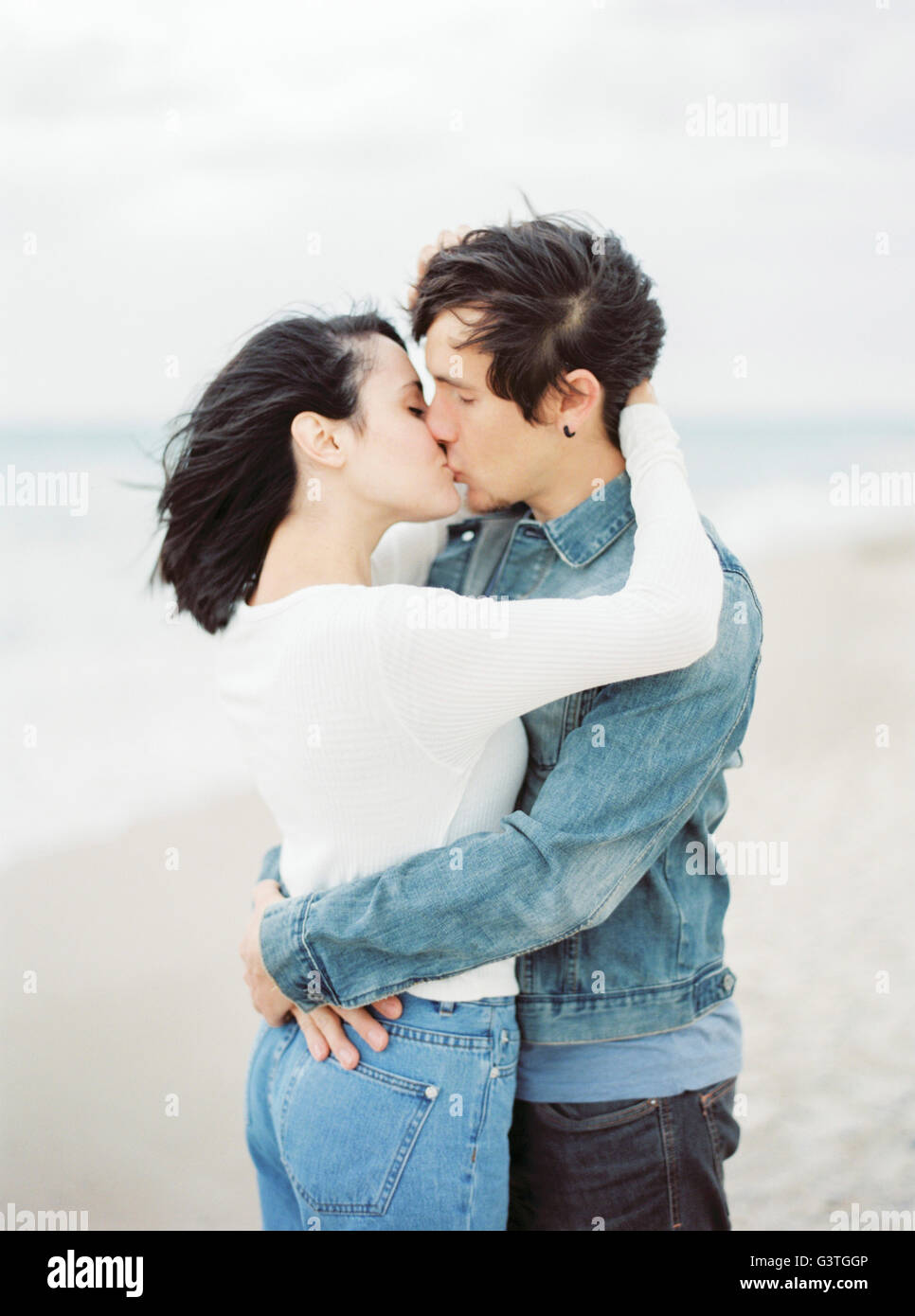Spain, Valencia, Couple embracing and kissing - Stock Image