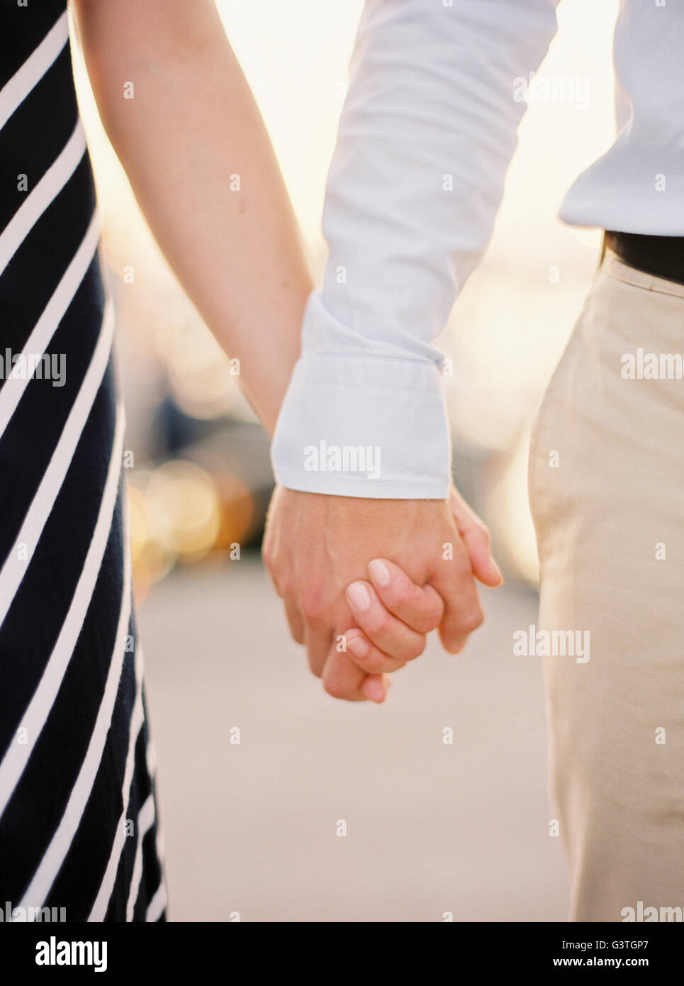 Sweden, Halland, Couple holding hands - Stock Image
