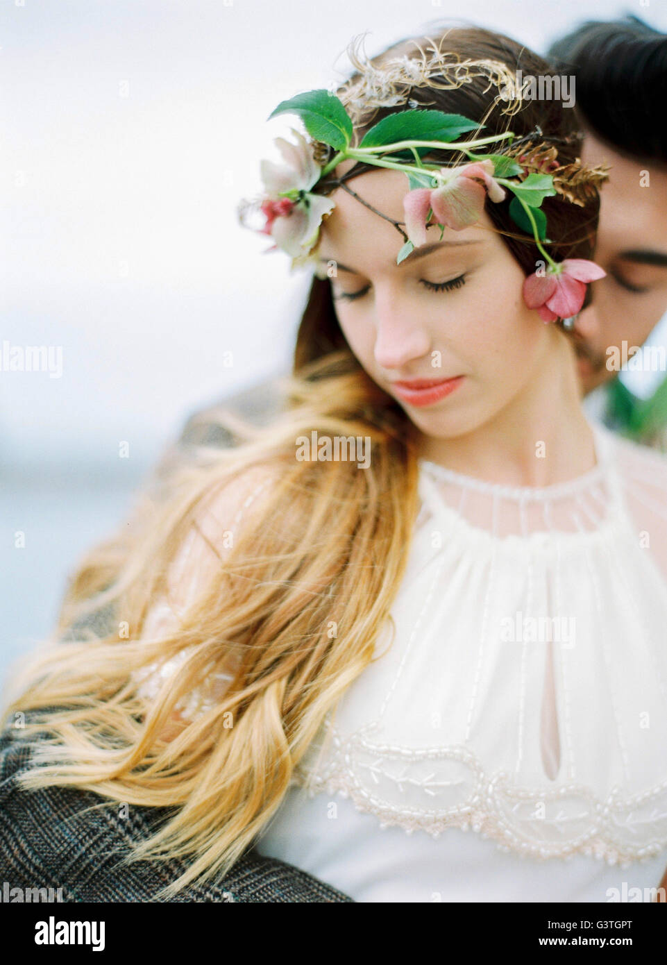 Sweden, Halland, Varberg, Bride and groom hugging - Stock Image
