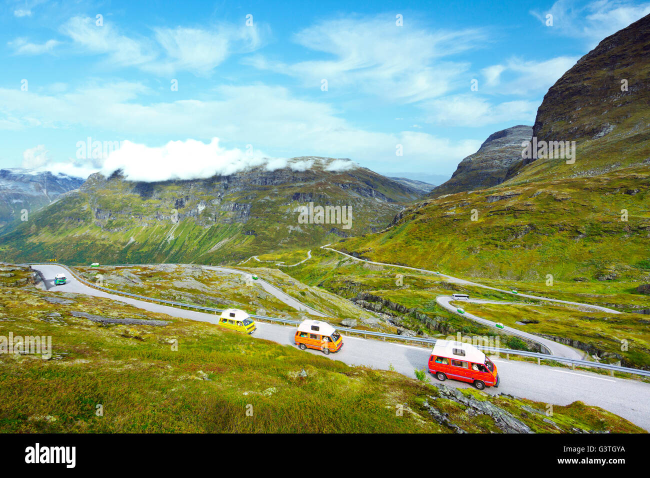 Norway, More og Romsdal, Sunnmore, Elevated view of cars on mountain road - Stock Image