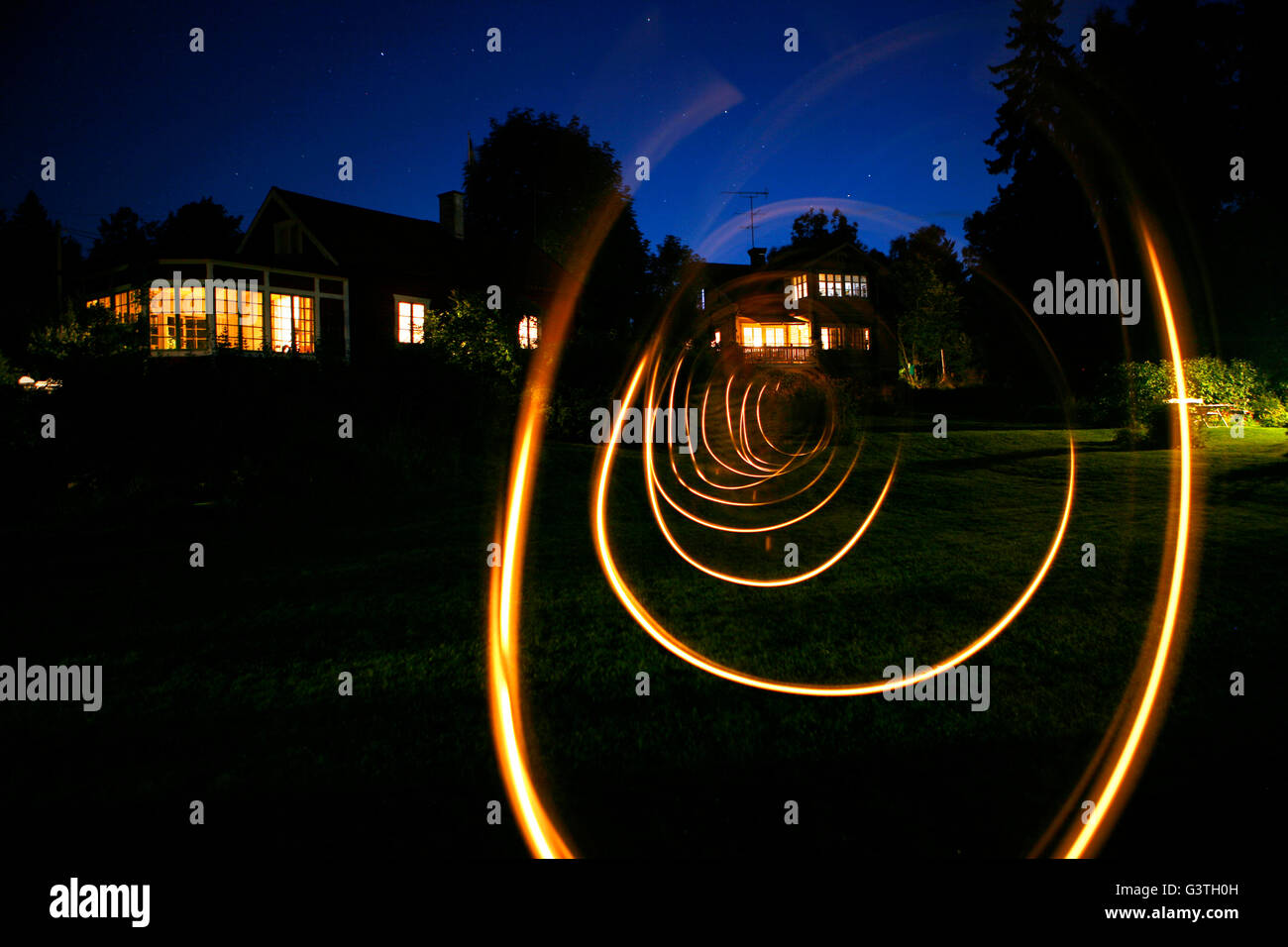 Sweden, Uppland, Loparo, View of spiral light trail in back yard - Stock Image