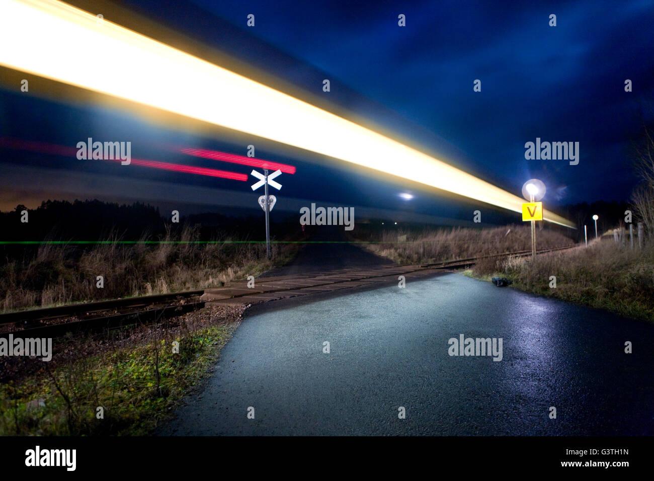 Sweden, Atvidaberg, Falerum, Light trail of passing train - Stock Image