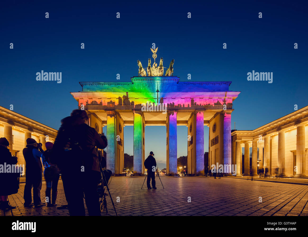 Germany, Berlin, Brandenburg Gate, View of colorful illumination at dusk - Stock Image