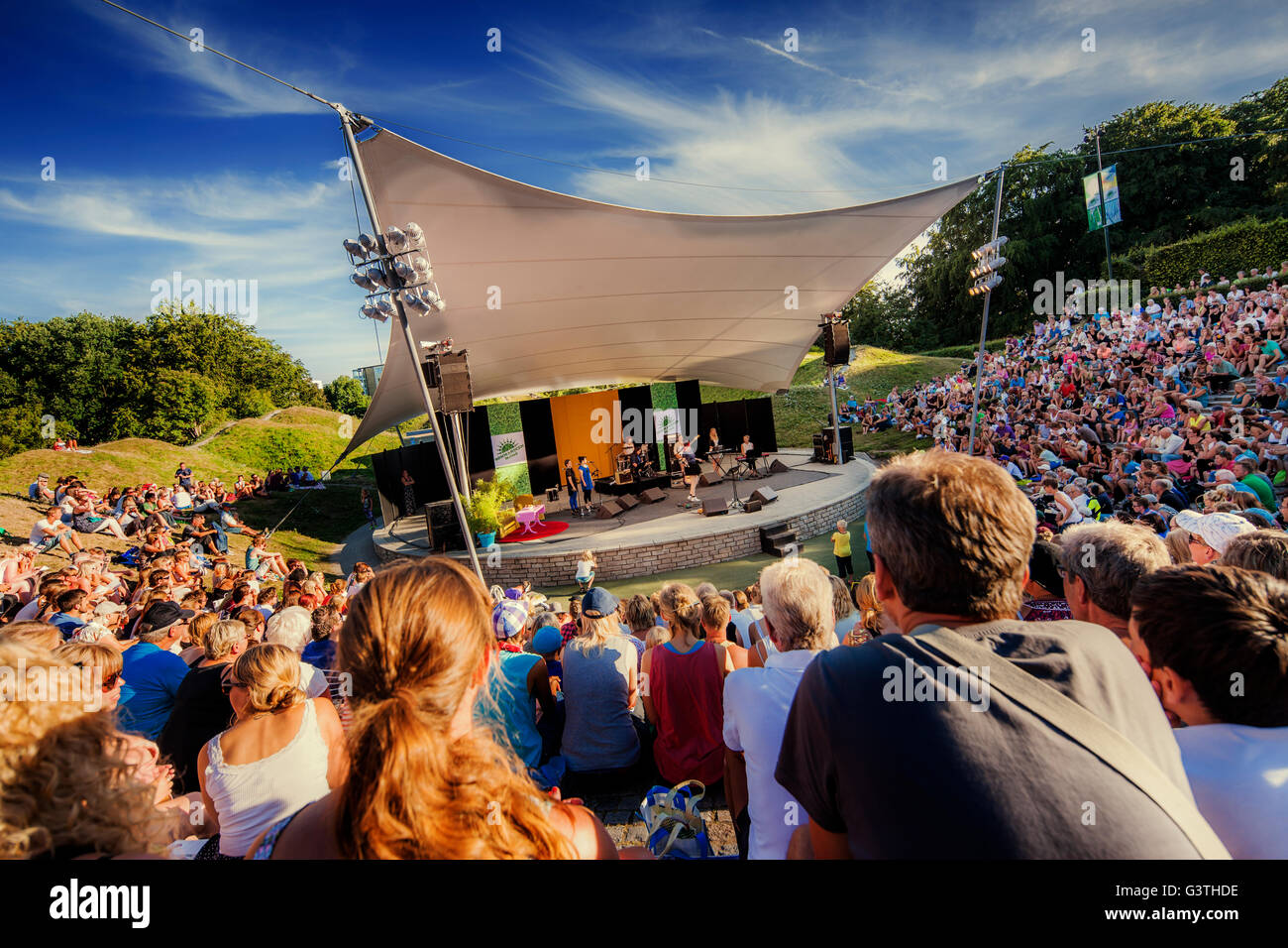 Sweden, Skane, Malmo, Crowd watching performance taking place on outdoor stage - Stock Image