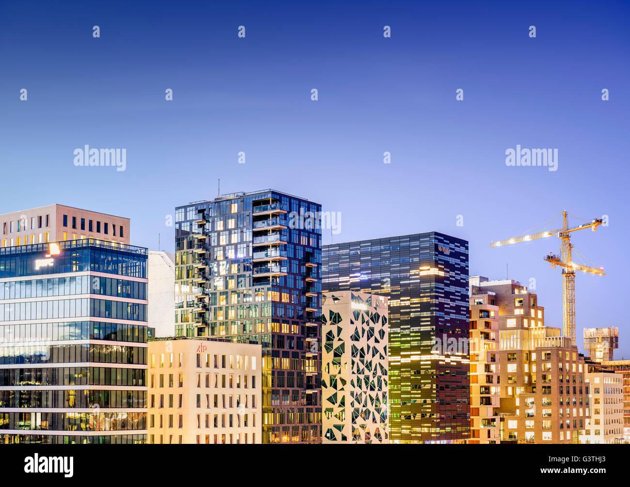 Norway, Oslo, Bjorvika, View of cityscape in night - Stock Image