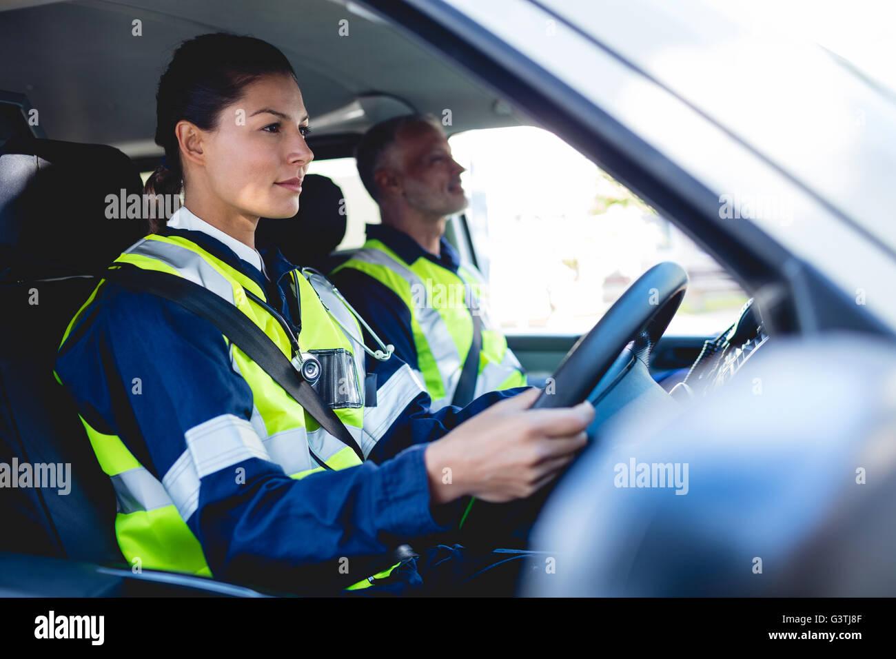 Ambulancewoman driving ambulance car - Stock Image