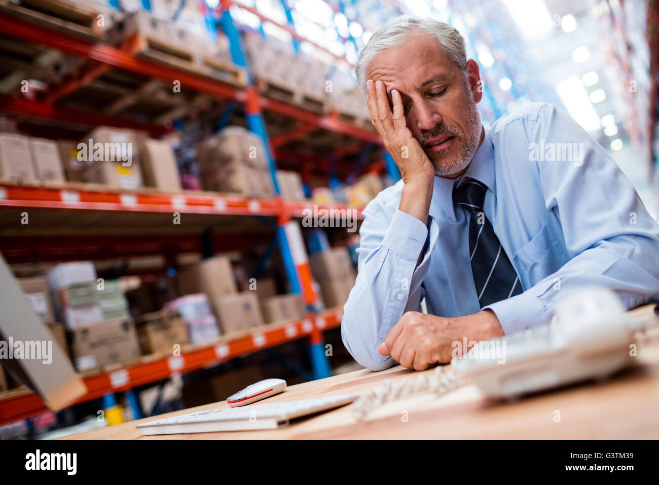 Anxious warehouse manager - Stock Image
