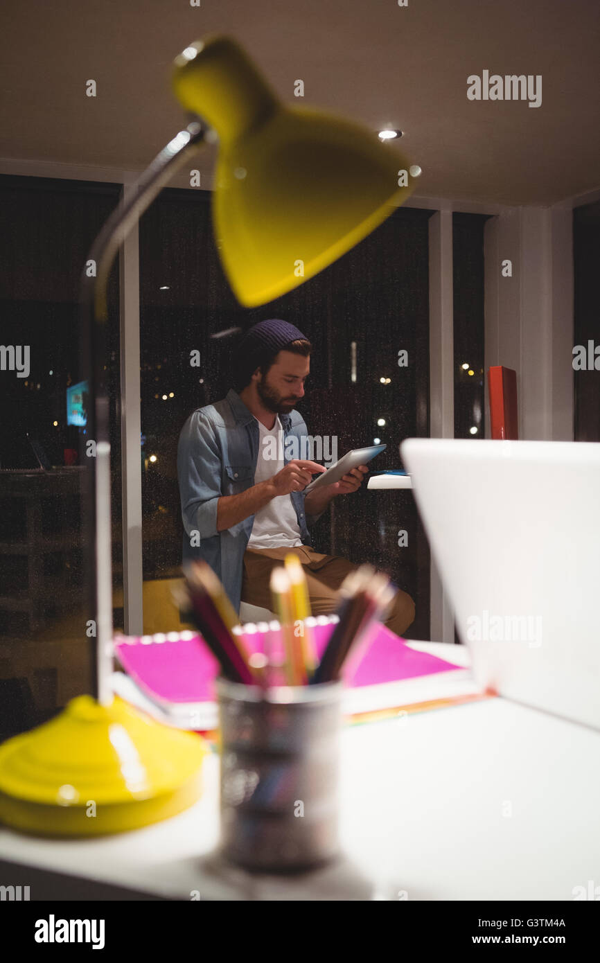 Hipster using a tablet computer Stock Photo