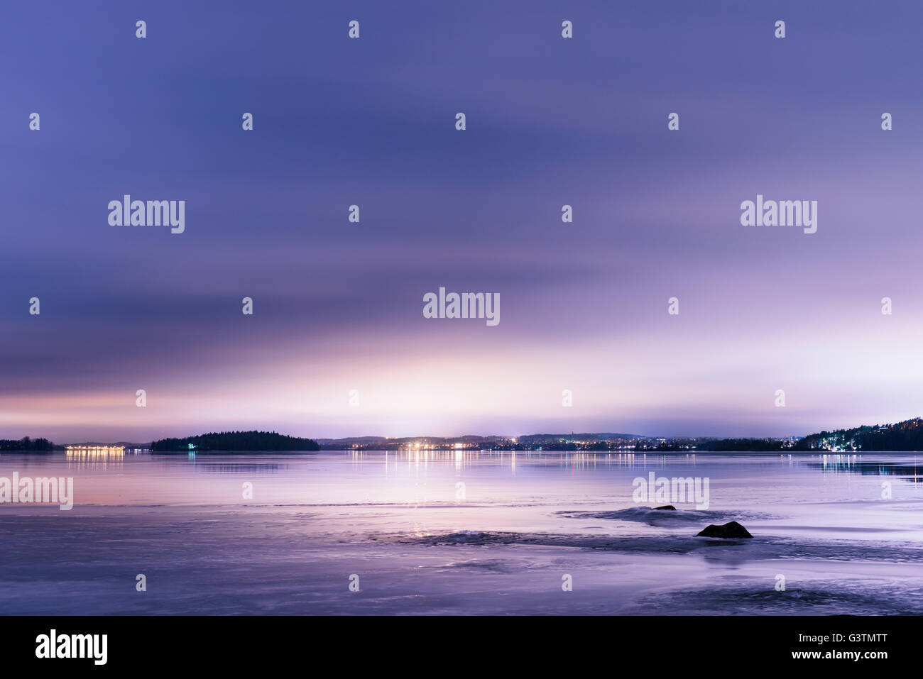 Finland, Pirkanmaa, Tampere, Pyhajarvi, Lake under purple sky at dusk - Stock Image