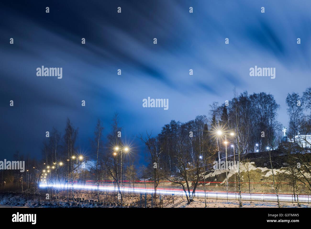 Finland, Pirkanmaa, Tampere, Kekkosentie, Light trail on road at night - Stock Image