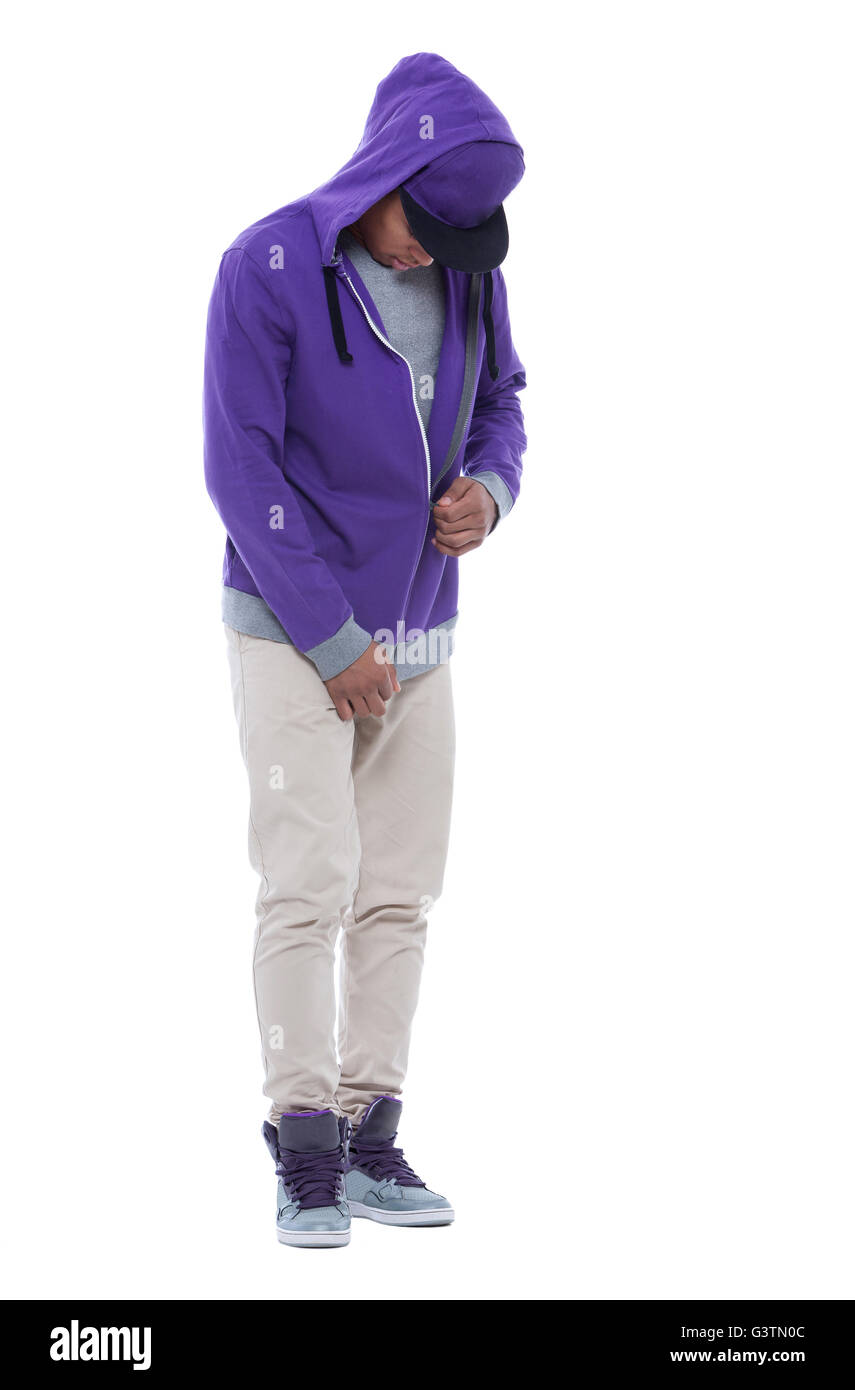 Young and careless afro man zipping his sweatshirt. Isolated image on white background. - Stock Image