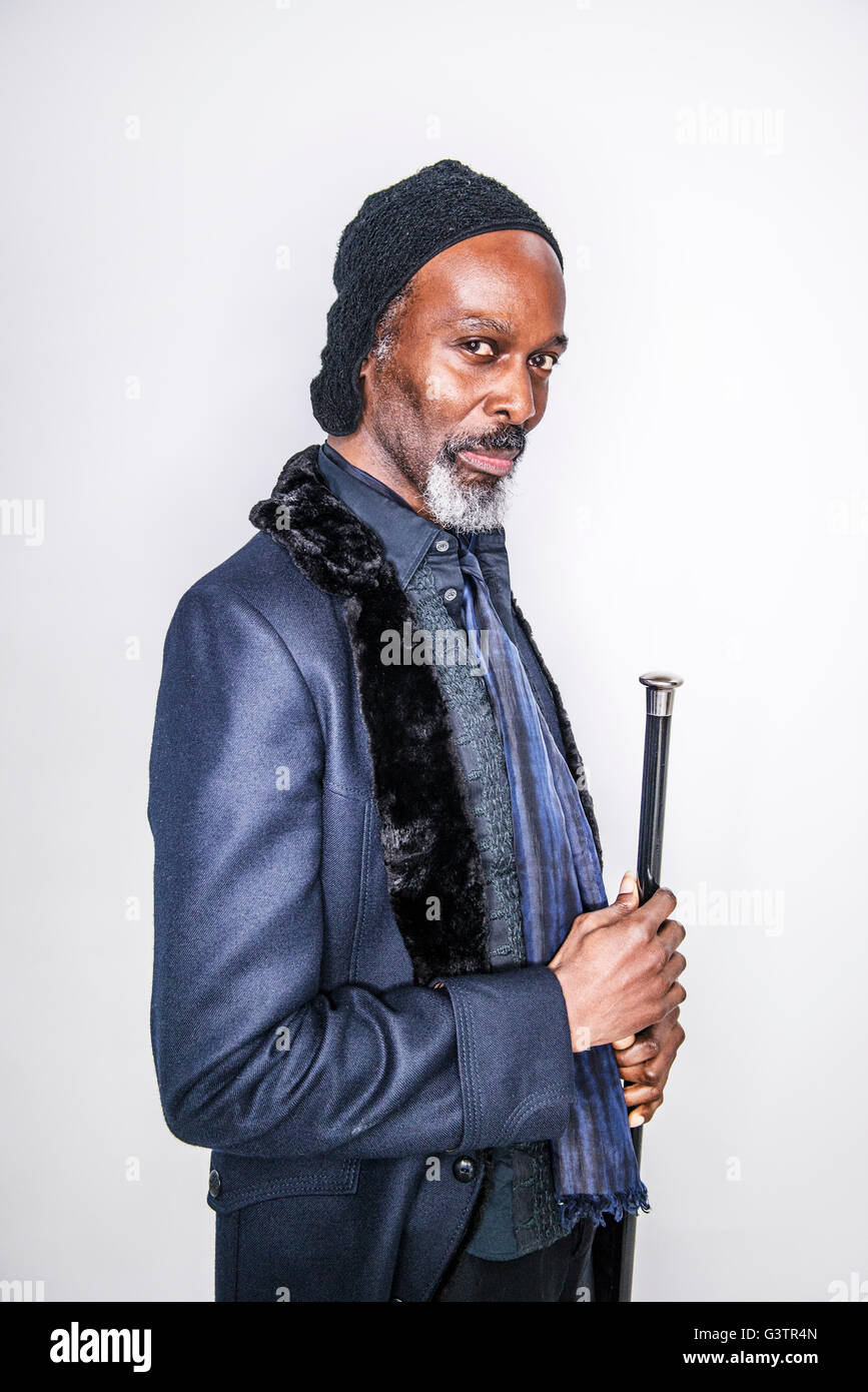 A mature african man posing in a studio looking cool. - Stock Image