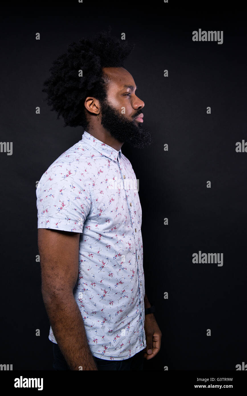 Studio portrait of a hip looking afro caribbean man. - Stock Image