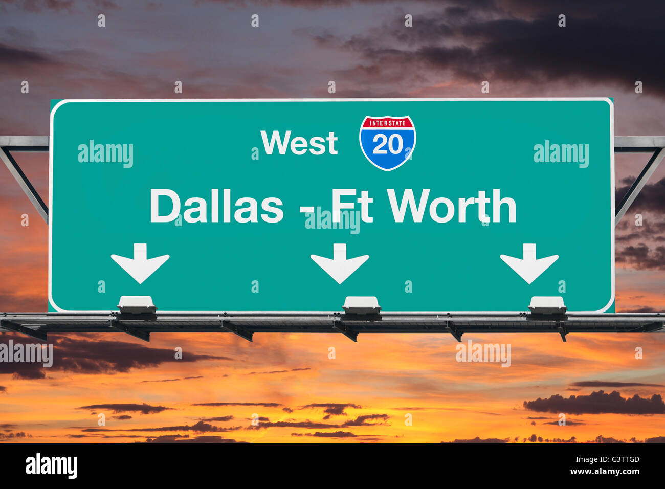 Dallas Ft Worth Interstate 20 west highway sign with sunrise sky. - Stock Image