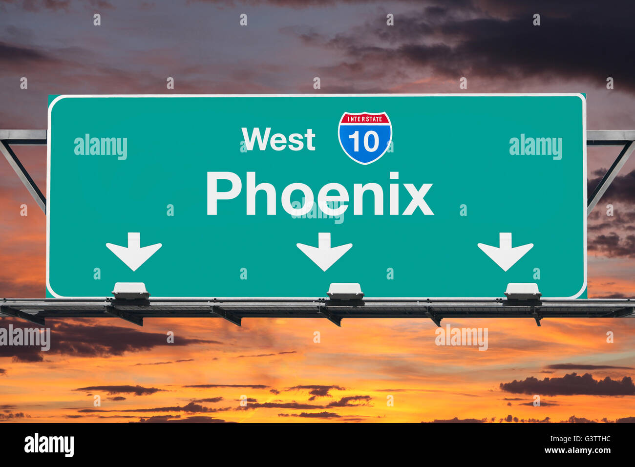 Phoenix Interstate 10 west highway sign with sunrise sky. - Stock Image