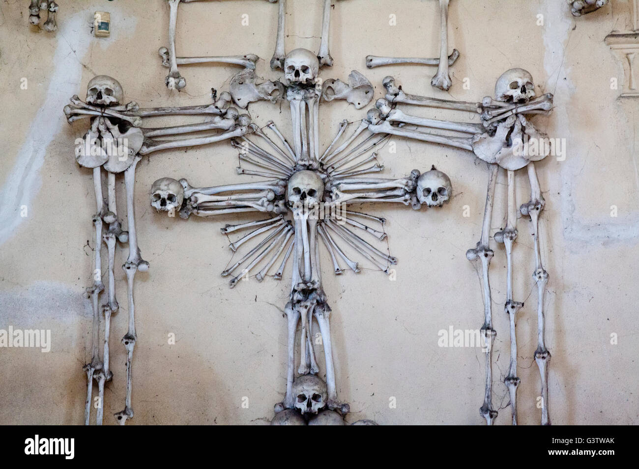 A cross made of human bones above the entrance to the vault of the Sedlec Ossary near Kutna Hora, Czech Republic - Stock Image