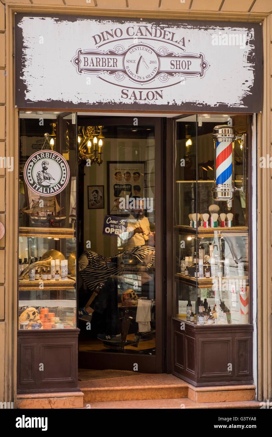 Dino Candela barber shop , salon, on Via Carbonesi, Bologna, Italy. - Stock Image