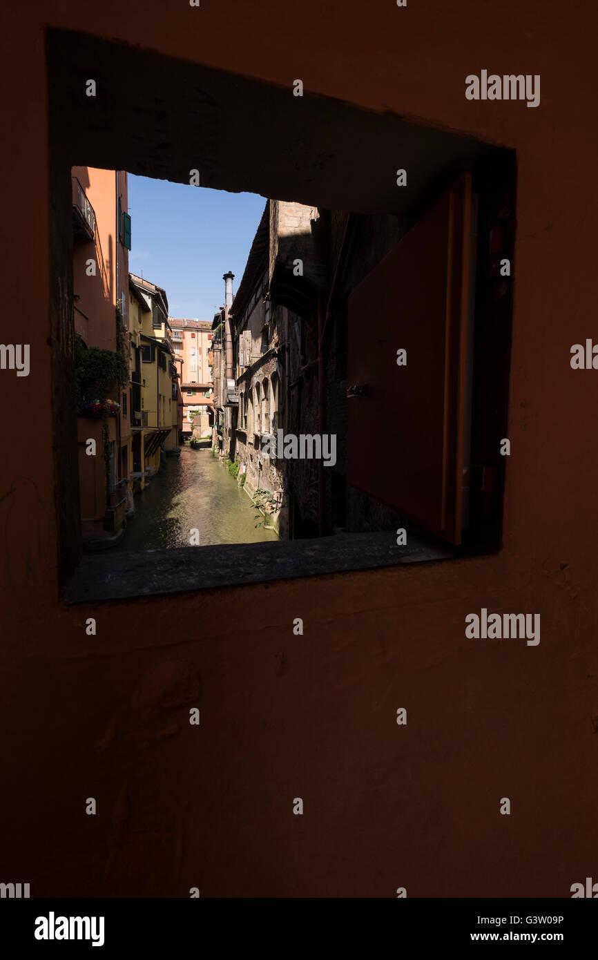 The window over the canal Reno in Via Piella, Bologna, Italy - Stock Image