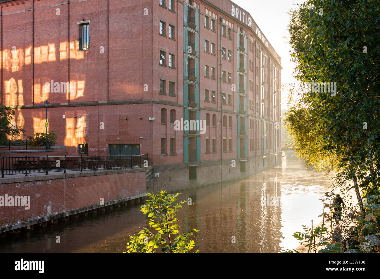 The British Waterways building with early morning sunlight and mist on the Nottingham and Beeston Canal in the city - Stock Image