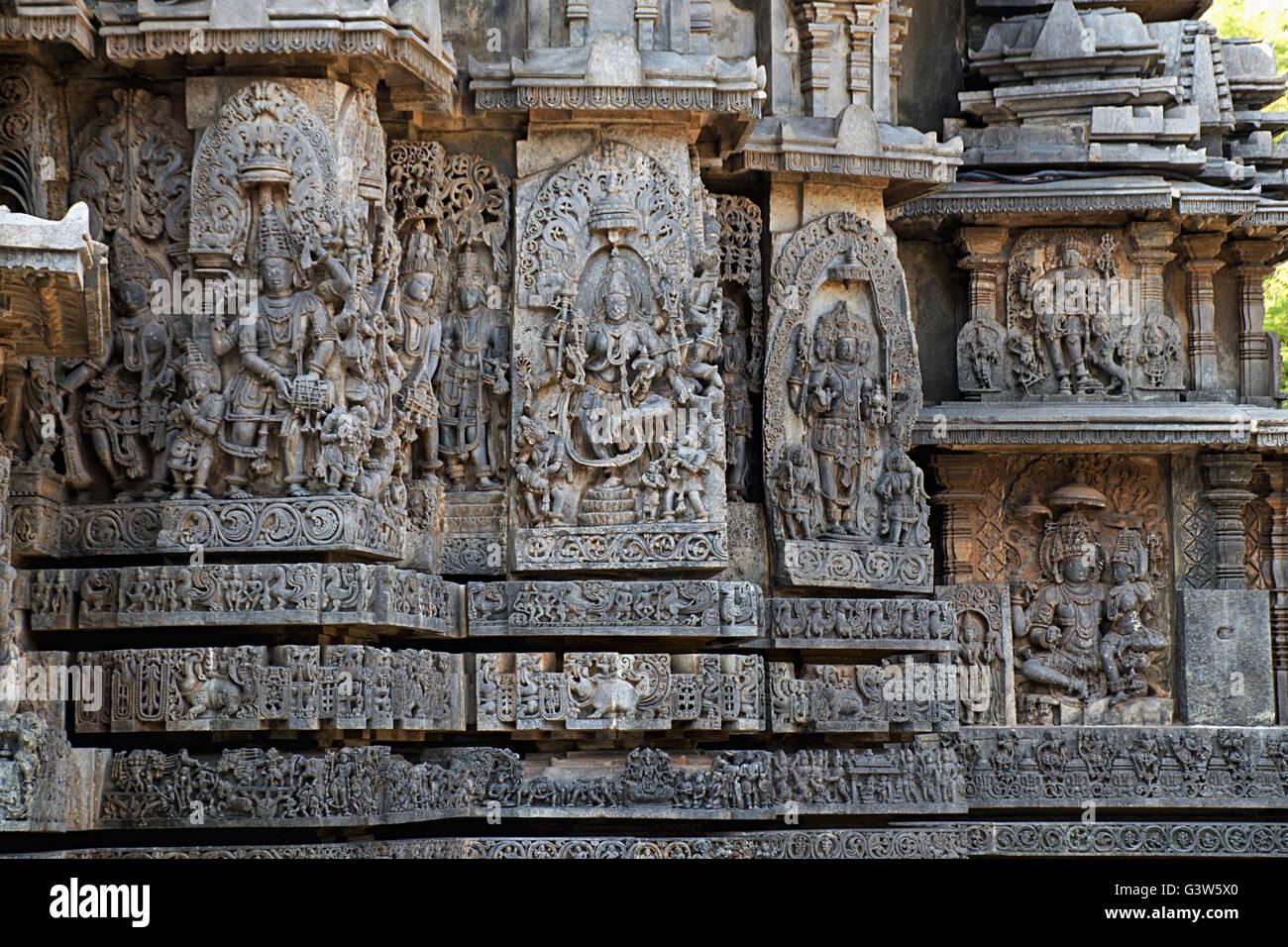 Ornate wall panel reliefs depicting Hindu deities, west side, Hoysaleshwara temple, Halebidu, Karnataka, india. - Stock Image